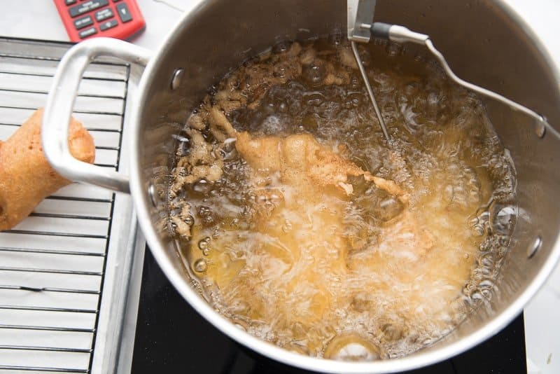 The beer-battered cod will fry for a 9-10 minutes in hot oil