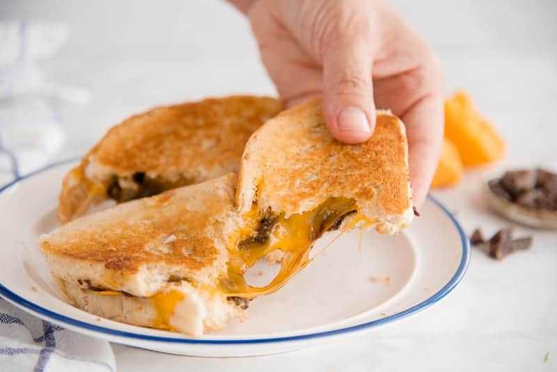 An epic cheese pull from the Grilled Cheese and Chocolate Sandwich