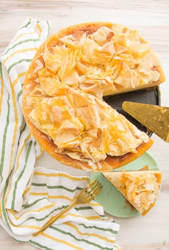 An overhead portrait of a cut Honey Cheesecake with Baklava Crust
