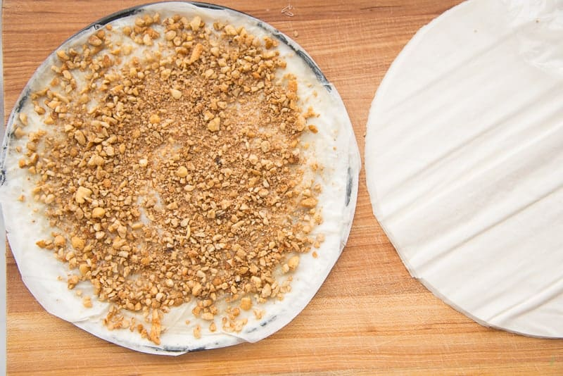 sprinkled nut blend on top of five layers of phyllo dough