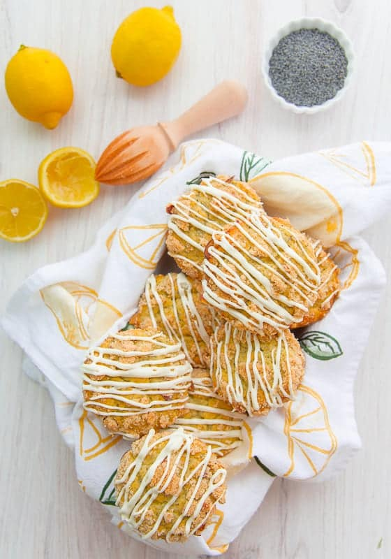 A portrait image of a basket filled with Lemon Poppy Seed Muffins
