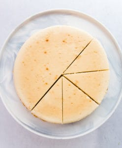An overhead image of a sliced Classic Cheesecake