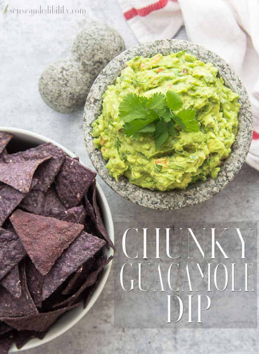 Chunky Guacamole is what your fiesta is missing. A creamy avocado dip is studded with fresh vegetables and herbs. Serve with crunchy corn tortilla chips. #guacamole #chunkyguacamole #avocadosfromMexico #dip #cincodemayo #starters #appetizers via @ediblesense