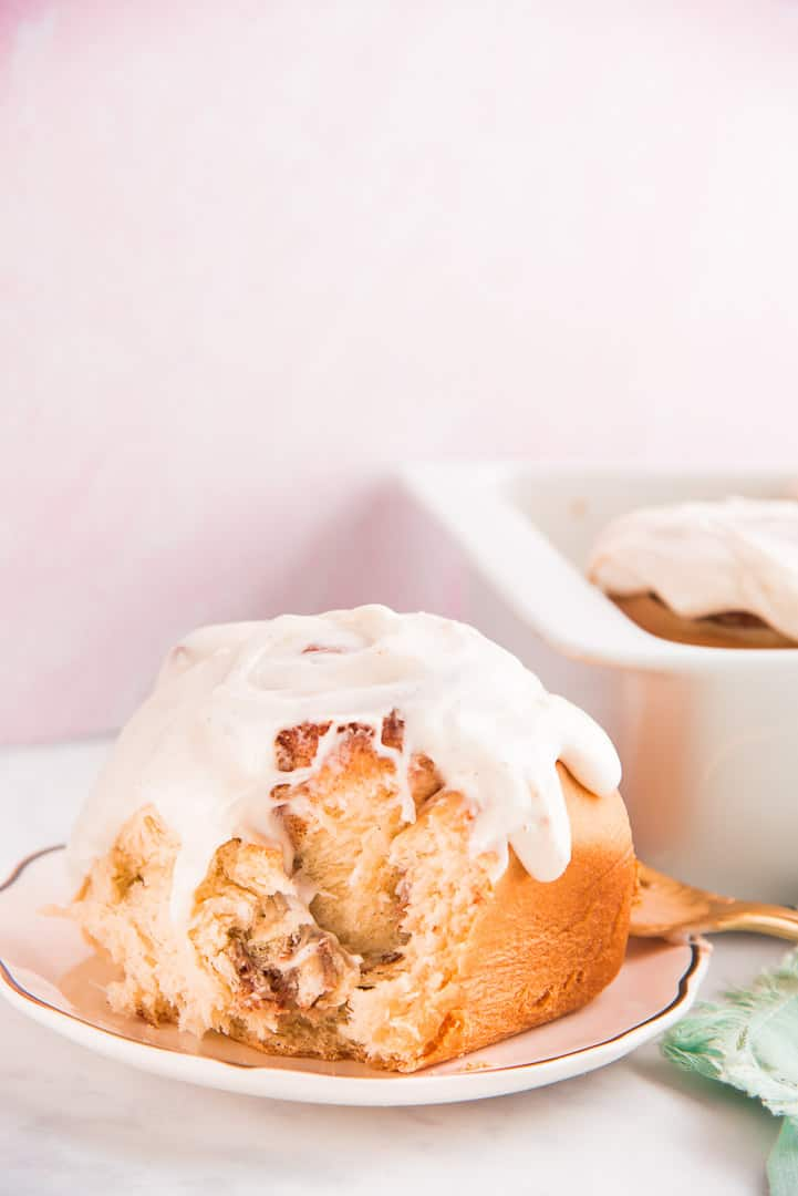 A Flaky Cinnamon roll has a bite taken out of it