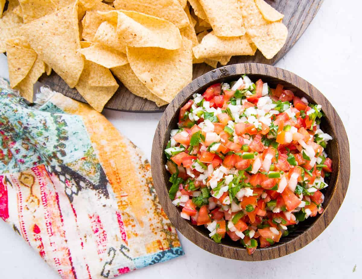 An overhead horizontal image of a bowl filled with pico de gallo.