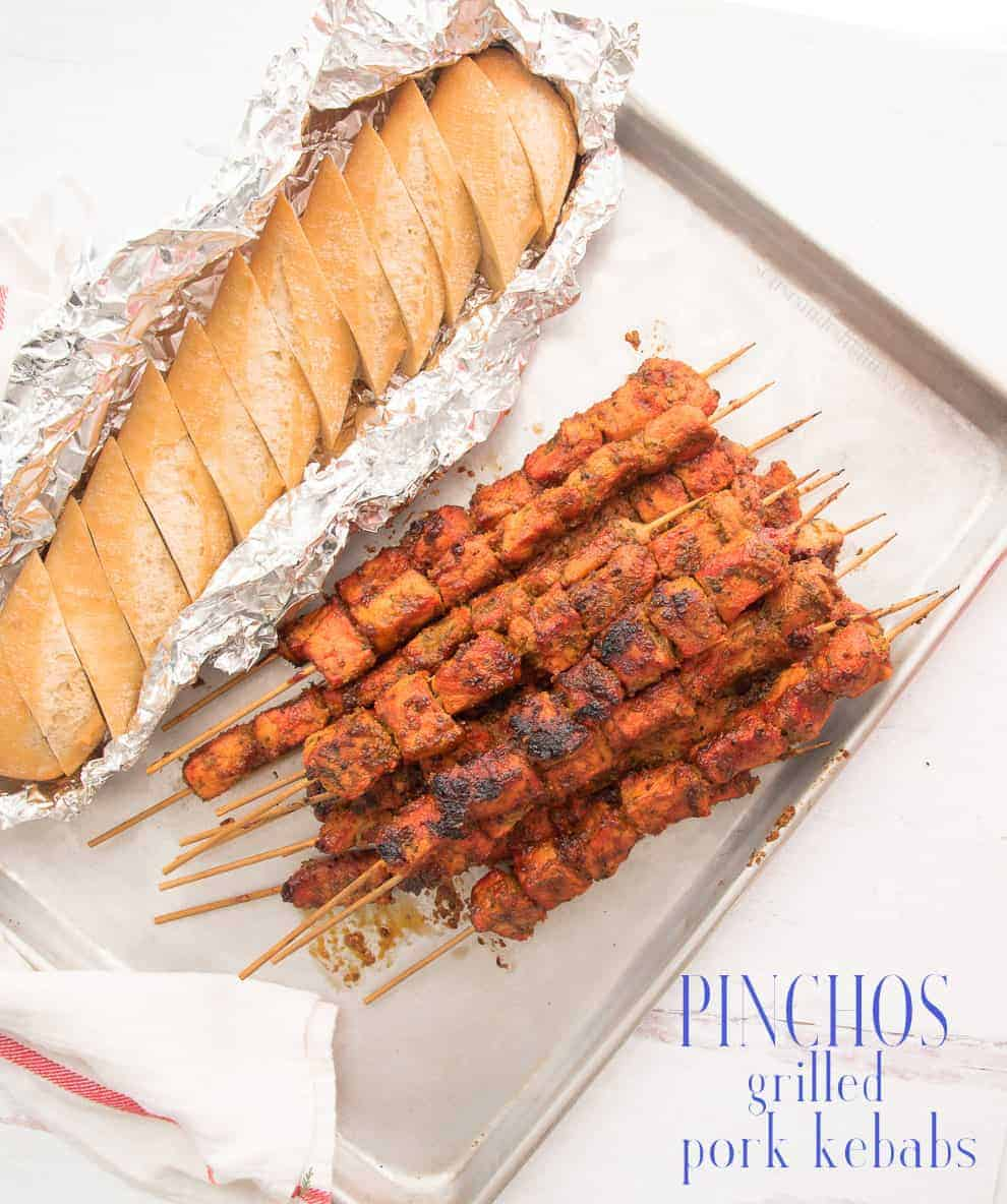 Pinchos are flavorful, grilled pork kebabs that are a popular street food in cities with large Puerto Rican populations. Marinated with herbs and spices and grilled to perfection over charcoal. #pinchos #pork #porkkebabs #grilling #grilledmeat #porkskewers #porkkabobs #puertorican #nyceats #cuchifrito #streetfood #meatonastick #hispanicfood via @ediblesense