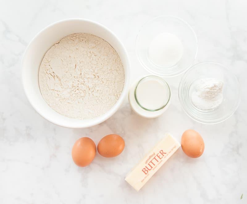 The ingredients to make Waffles: flour, sugar, salt, baking powder, sweet cream, eggs, and butter