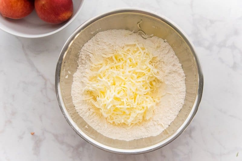 The cold butter is shredded into the flour