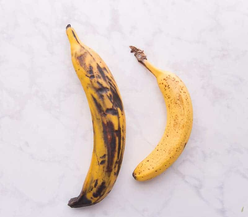 Image of a yellow plantain and a banana side by side.