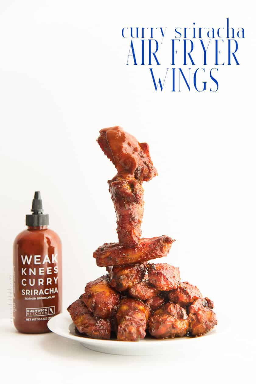 Curry Sriracha Air Fryer Wings will change everything you know about flavorful wings! Make these wings in less time (and oil) with more flavor than you knew was possible. #bushwickkitchen #currysriracha #chickenwings #wings #airfryer #airfryerrecipes #wingrecipe #currymarinade #curriedwings #jamaicancurry #srirachawings #gamedayrecipes #gamedayeats #appetizers #starters #chickenrecipes #cookingintheairfryer #dinner #lunch #easyrecipes #redstripe #weakknees #beesknees  via @ediblesense
