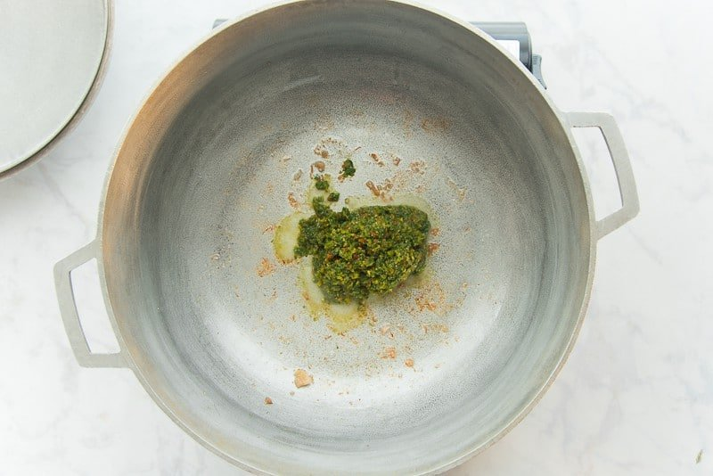 Sofrito is sauteed in rendered lard in a silver pot