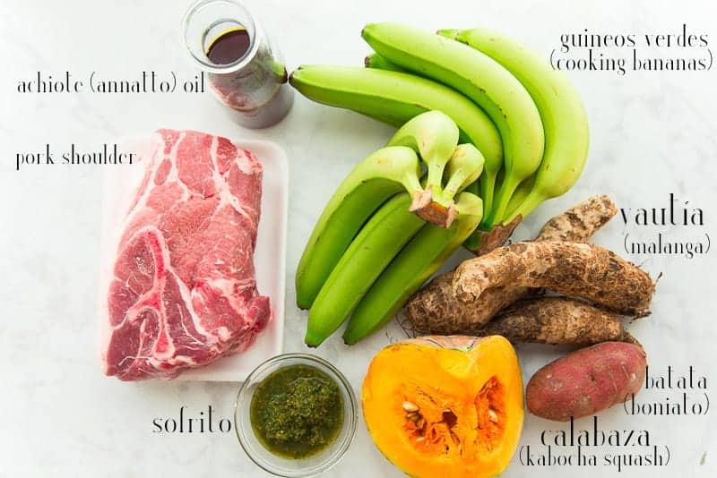 Ingredients to make pasteles: pork shoulder, achiote oil, green cooking bananas, yautía, boniato (white sweet potato), calabaza, sofrito.
