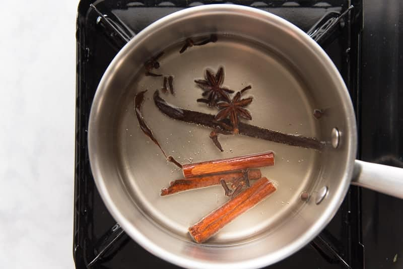 A tea of spices simmering in a silver pot