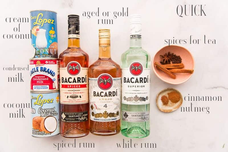 Ingredients for quick coquito: coconut milk, cream of coconut, condensed milk, añejo, spiced, and white rums, spices, cinnamon, and nutmeg