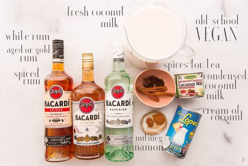 Ingredients for old-school (vegan) coquito: coconut milk, spices, condensed coconut milk, cream of coconut, nutmeg, cinnamon, white, añejo and spiced rums