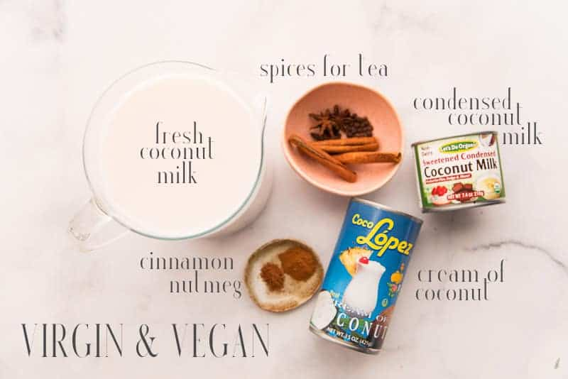 The ingredients for virgin, vegan coquito: coconut milk, spices, condensed coconut milk, cream of coconut, and cinnamon and nutmeg
