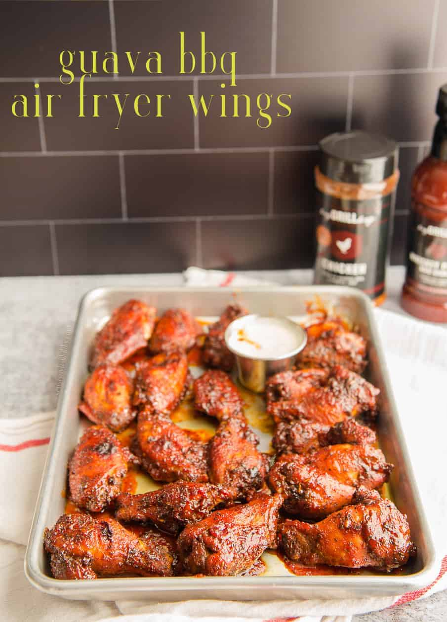 Add a tropical spin to your air fryer wings this weekend! A spice rub and bottled BBQ sauce make this flavorful recipe a breeze to whip up. #airfryerrecipe #airfryerwings #chickenwings #airfried #airfriedwings #buffalowings #heygrillhey #patioprovisions #everythingbbqsauce #guavarecipe #chickenrecipes #buffalowingrecipe #guavaBBQsauce #kid-friendly #easymeals #dinner #gameday #footballsnacks via @ediblesense