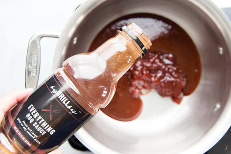 BBQ sauce is added to a silver pot with guava jelly