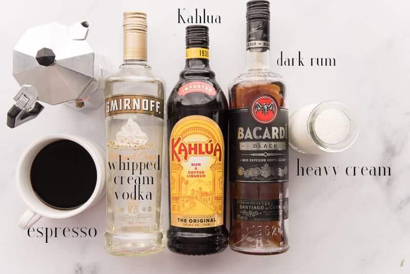 The ingredients needed to make Café con Leche Martini: espresso, Kahlúa, dark rum, and heavy cream