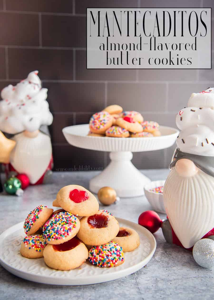 Mantecaditos are a beloved childhood cookie. This almond-flavored butter cookie is easy to make ahead and even easier to eat. Freezer-friendly, and customizable with your choice of toppings, it will be your go-to cookie recipe. #mantecaditos #galletas #biscuits #cookies #sprinkles #guavapaste #postres #galletitas #buttercookies #thumbprintcookies  #holidaycookies #holidaybaking #holidayrecipes #freezerfriendly #makeahead #baking #ediblegifts #recetas #recetadegalleta #Navidades  #Christmasrecipe #threekingsrecipe #LosTresReyes via @ediblesense
