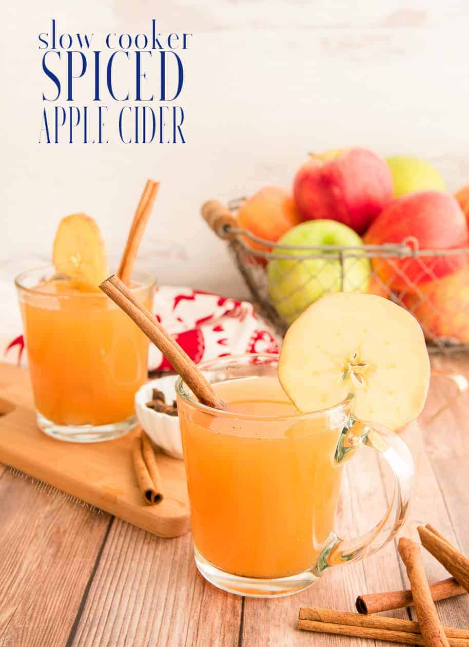 Slow cooker spiced apple cider is the easiest winter drink you can make. Get help from the store with bottled apple juice and make your own spiced version in a couple of hours. #applecider #slowcookerrecipe #slowcookerdrink #winterdrink #appleseason #applejuice #holidaydrinks #coldweatherdrinks #kidfriendly #easyrecipe #slowcooker #winterfun #holidaydrink #Thanksgiving #Christmas #holidayparty #drinkrecipe #Halloween #partyfood #cinnamon via @ediblesense