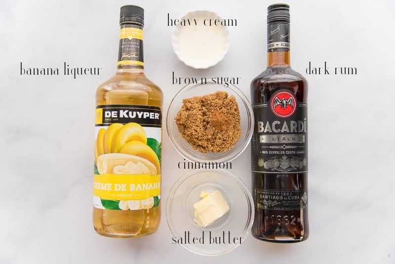 The ingredients to make the Rum Caramel Sauce: rum, banana liqueur, cream, brown sugar, cinnamon and salted butter