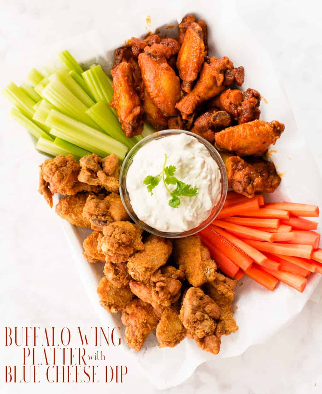 This Buffalo Wing Platter with Blue Cheese Dip holds flavorful fried chicken wings and buffalo wings and comes complete with a made from scratch, sour cream and buttermilk-based blue cheese dipping sauce. #gameday #buffalowings #chickenwings #bluecheesedip #bluecheese #friedchicken #partyfood #wings #wingsandbeer #gamedayfare #gamedayrecipes #biggamesnacks #snackfood #partyfoodrecipes #chickenwingsanddip #wingplatter #buffalowingplatter via @ediblesense