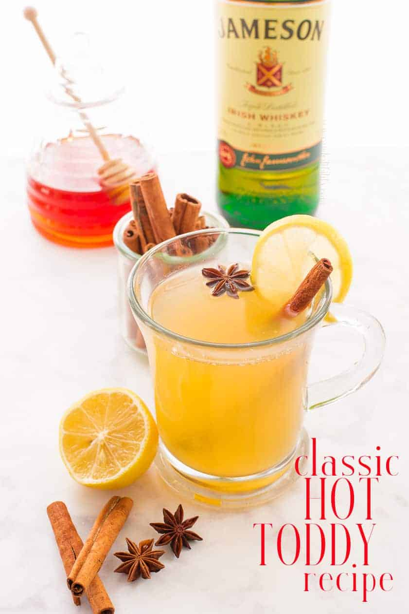 A Classic Hot Toddy will soothe sore throats and warm cold bodies. Make the tea for this classic warm drink up to one month ahead to make it even easier. Kid-friendly options included. #hottoddy #toddy #warmdrink #drinksrecipe #cocktail #warmcocktail #whiskey #Irishwhiskey #scotchdrinks #whiskeydrinks #spicedtea #tea #lemon #honey #winterdrinks #coldremedy #sorethroatrecipe #recipesforsorethroat #drinkstosoothesorethroats via @ediblesense