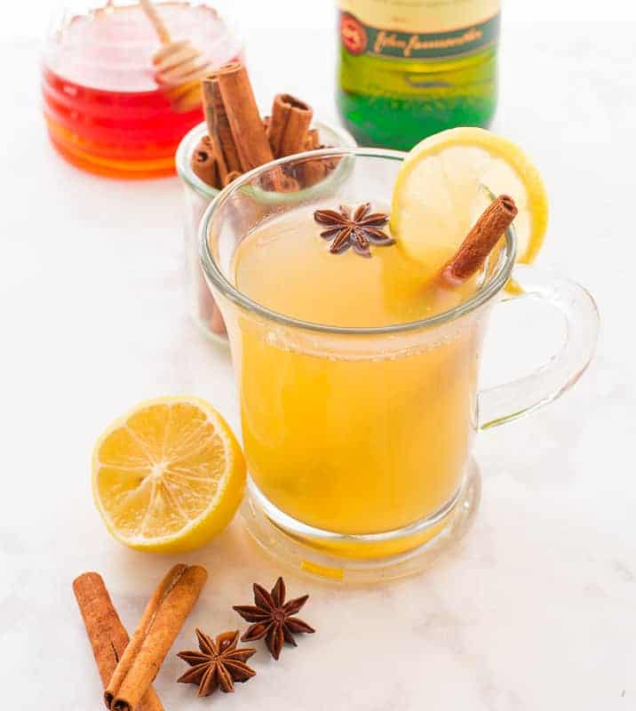 The Classic Hot Toddy garnished with a cinnamon stick, star anise, and lemon slice.