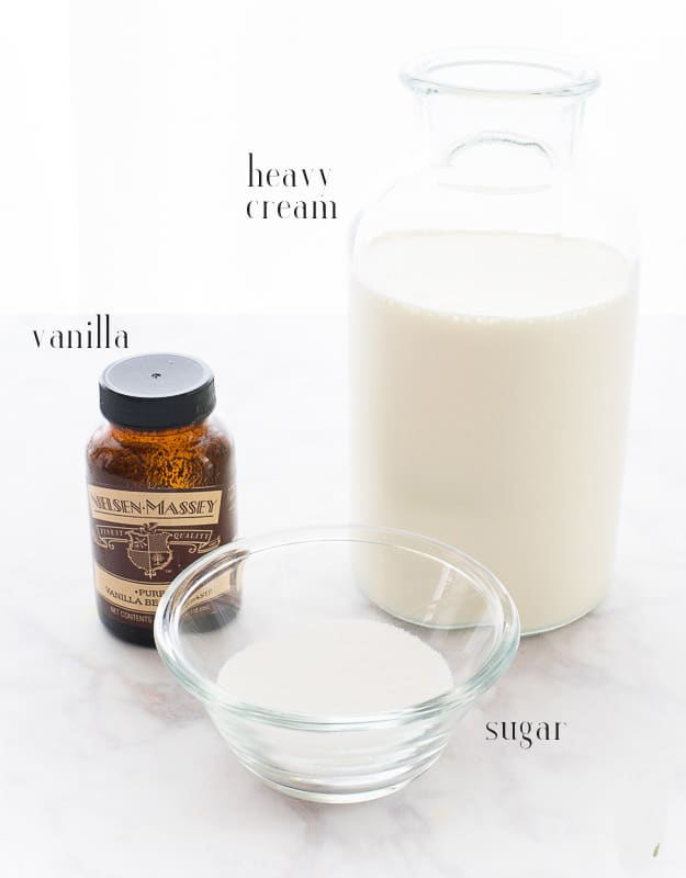 Ingredients to make whipped cream filling for Cream Puffs: heavy cream, vanilla, and sugar