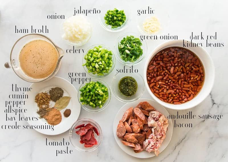 Ingredients for the recipe: onions, jalapeños, garlic, green onion, green pepper, celery, sofrito, kidney beans, andouille sausage, bacon, tomato paste, spices, and ham broth.