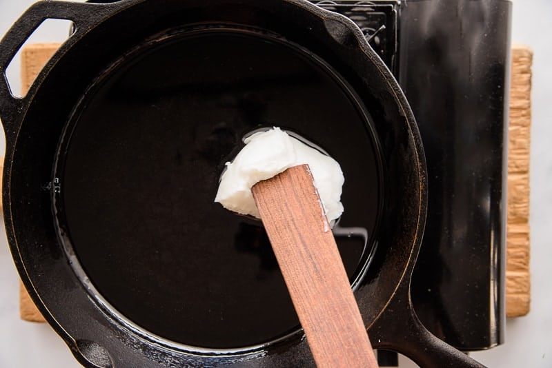 Lard is melted in a cast iron skillet