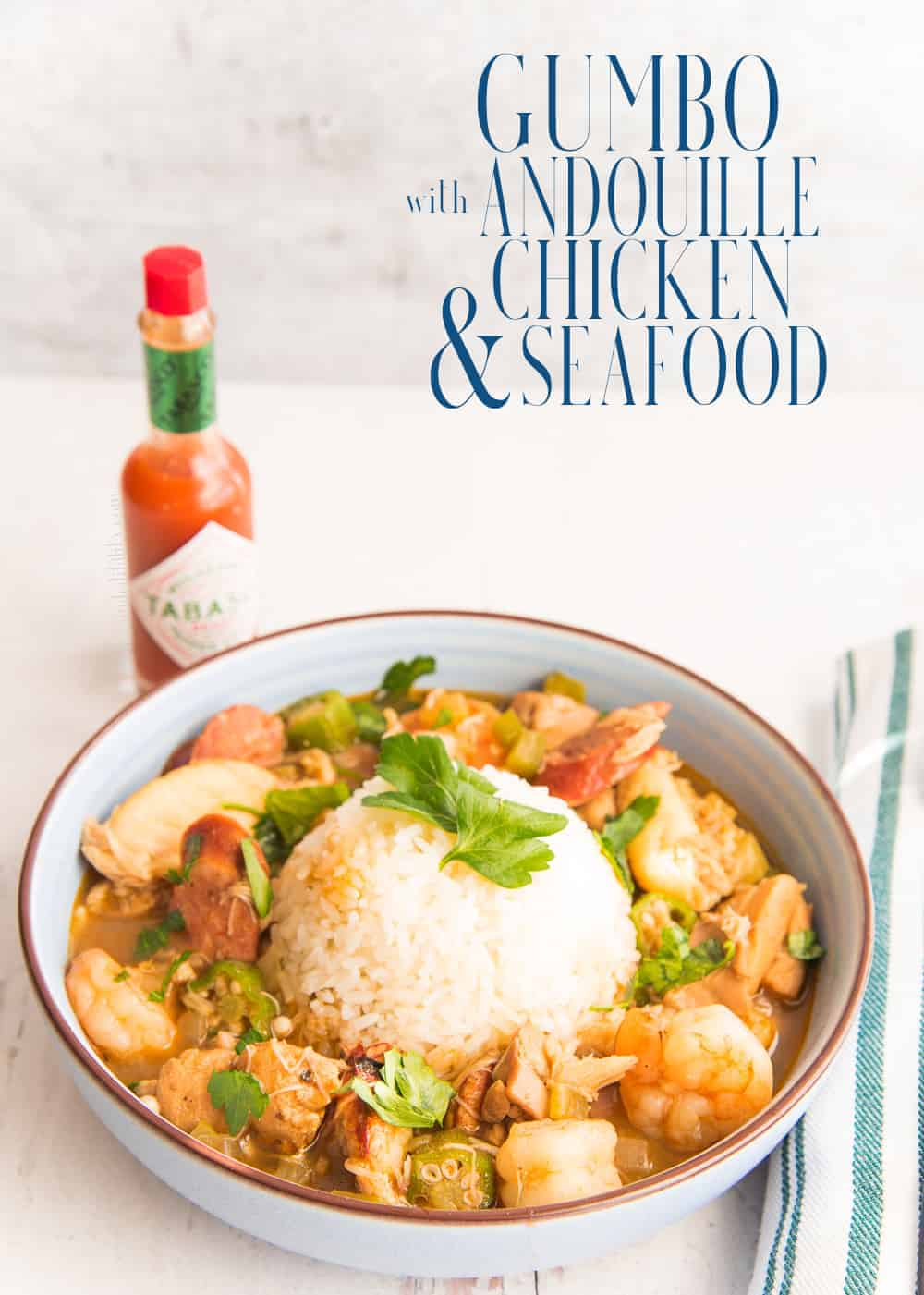 Gumbo is a North American favorite. Make yours flavorful with a deep roux, spiced sausage, chicken, and plump crab and shrimp. Gluten free. #gumbo #chickengumbo #seafoodgumbo #creolegumbo #cajungumbo #Creole #Cajun #NewOrleans #gumborecipe #dinnerrecipe #soup #stew #MardiGrasrecipe #Christmasgumbo via @ediblesense