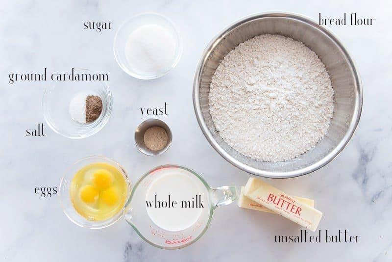 Ingredients for King Cake: sugar, bread flour, butter, milk, eggs, yeast, salt, cardamom