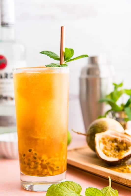 Highball Passion Fruit Mojito with fresh passion fruit pulp in the bottom of the glass