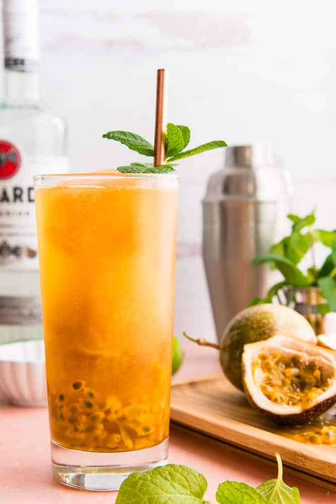 Lead image of Sense & Edibility's Passion Fruit Mojito in a clear tall glass.