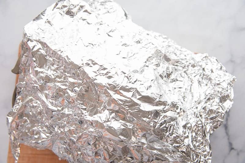 Foil tents a ham after it's been roasted.