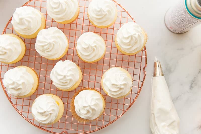 Cupcakes topped with piped Swiss meringue topping.