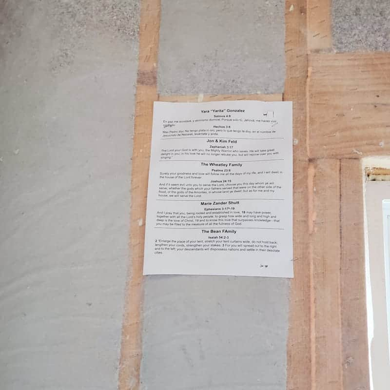 Adding Scripture to the framing of houses during the building