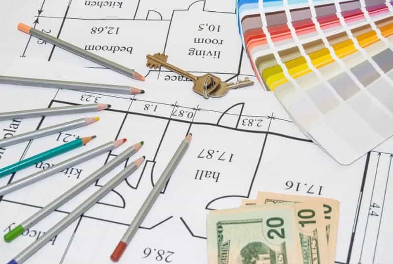 Blueprints and money with markers and paint swatches