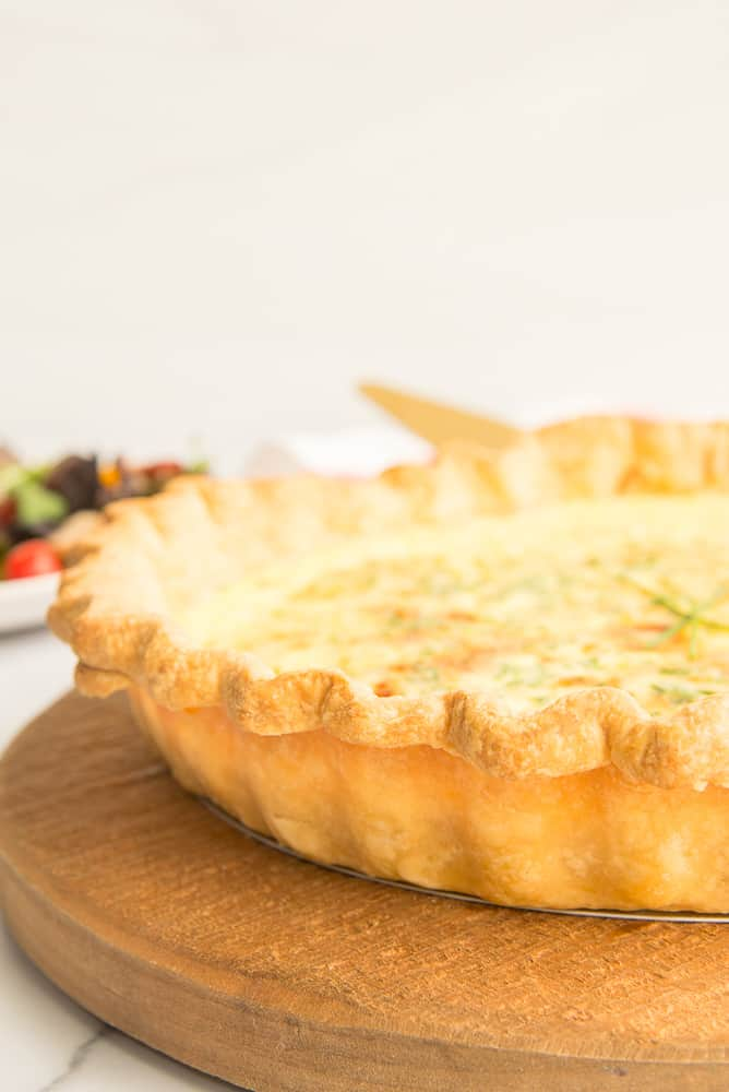 Lead image of flaky pie dough baked into a quiche crust
