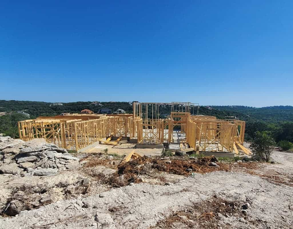 Custom Home Build in the framing stages with blue sky