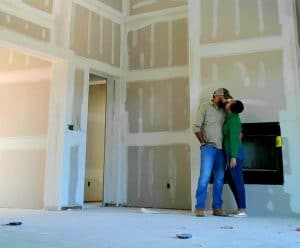 Preview of the Framing and Building Phase of a Custome home Build two people kissing.