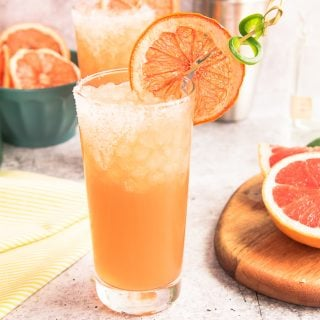 Spicy Paloma preview image highball glass with a dried grapefruit and jalapeño twist garnish