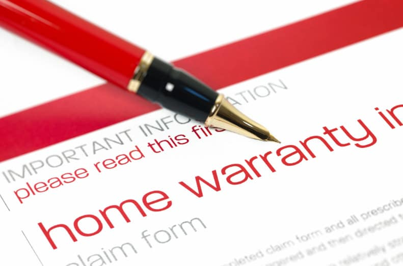 White piece of paper with red Home Warranty text