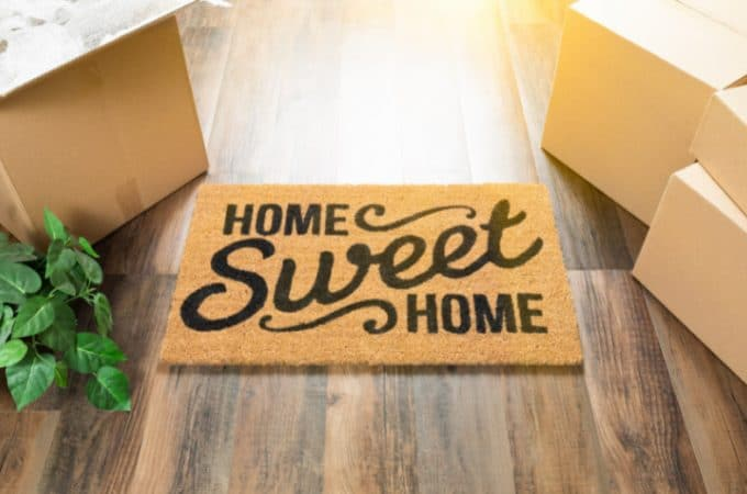 Wood flooring with a Home Sweet Home jute rug on it