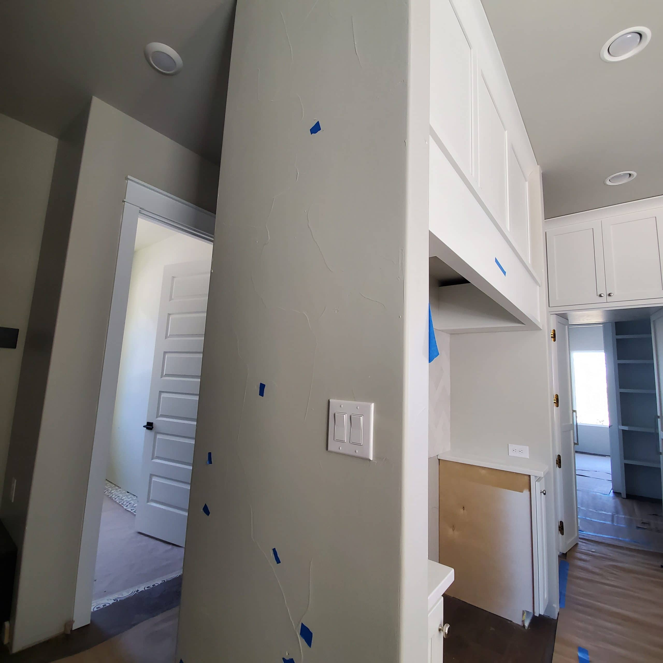 Punch lists and closing post shows grey wall in kitchen with blue painter's tape on different spot.
