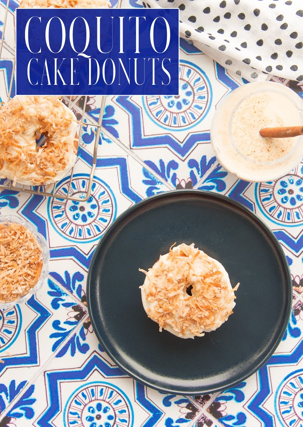 Coquito Cake Donuts take the popular Puerto Rican holiday cocktail and make it edible for breakfast, brunch, or dessert. Made with a creamy coconut-rum icing and topped with cinnamon-dusted coconut flakes, you'll be glad to enjoy this every day of the year. #coquito #coquitodonuts #recetasPuertorriqueñas #PuertoRicanrecipes #PuertoRicanCoquito #coconutrum #coconuteggnog #recetasnavideñas #holidayrecipes #cakedonuts #breakfastdonuts #donutrecipes via @ediblesense