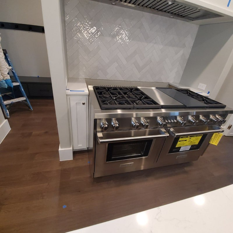 """Image of a 60"""" range oven in a kitchen."""