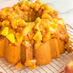 Preview image of the baked Remy Pound Cake with Peach Topping on a copper cooling rack